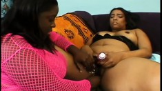 Curvaceous black slut is licked and fingered by fascinating ebony female