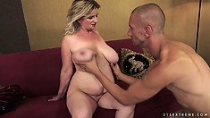 Fat mature blonde wiggles her furry wombat and he plays with her juggs