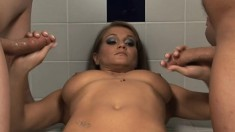 Rita Faltoyano strokes two dicks at once all over her big tits
