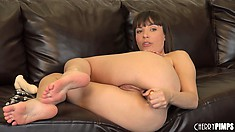 Surprised looking Dana DeArmond performs vaginal manipulation
