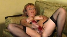 Horny redhead mom in black stockings Jill pleases herself on the couch