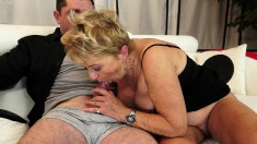 Busty blonde granny has a juicy snatch longing for a young man's cock