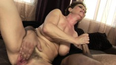 Sexy mature woman with big breasts works her hairy twat on a hard pole
