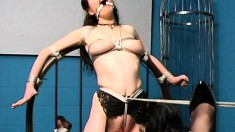 Kinky brunette with big tits feeds her desire for bondage and pleasure