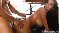 Ava Addams looks over her shoulder while her man plows at her