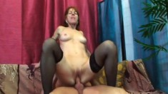 Buxom lady in stockings Ivet can't resist a young man with a big cock