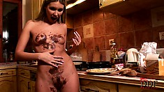 Blonde mom makes a melty chocolaty mess all over her body in the kitchen