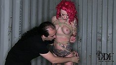 He ties her up hanging in the air and on the ground to punish her
