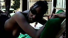 Attractive ebony chick shows off her lovely body and gets banged hard by the pool