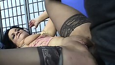 Inked hottie gets down on her knees to suck on an XXL meat stick