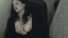 Hidden camera catches the naughty secretary fingering between her legs