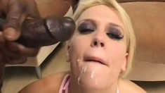 Three hung brothas tear into a horny blonde bitch on the couch