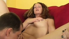 Curly MILF with big fake tits and still tight body getting shagged