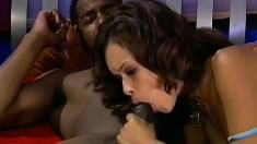 Striking brunette in blue lingerie has a huge black dick filling her tight pussy