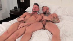 Cy Kohen and Christian Matthews having passionate gay sex on the bed