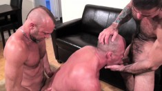 Horny dude has a dick filling his mouth and another drilling his ass
