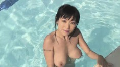 Busty young Jenny gets naked and rubs her sweet clit by the pool