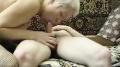 Short haired blonde mom in black stockings has sex with a young stud