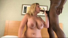 Curvaceous blonde milf plays out her fantasy with two black stallions