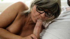 Busty mature lady finds it hard to resist a young man with a long dick