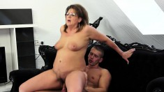 Naughty mature woman with big natural tits loves them young and horny