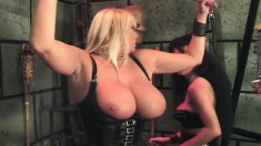 Huge tit blonde slave is strung up and tortured by her mistress