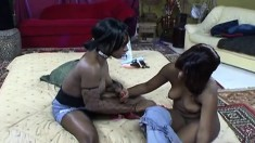 Wild black model enjoys fucking her girlfriend in the ass with a strap-on