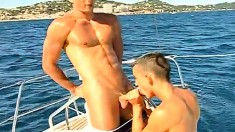 Handsome gay stud Fabrice Felder engages in hot anal sex on a boat