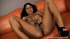 Hot Asian Kayme Kai bares her big boobies and splits her snatch with panties