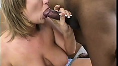 Eager MILF and young black charmer with a huge cock have a real fuck fest