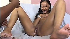 Lovely black lesbians use a strap-on dildo to take care of each other's sexual needs