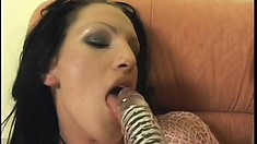 With the help of huge dildos, two lesbian roommates please each other's pussies