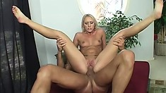 Dazzling blonde shows off her perfect body, blows a long dick and gets fucked deep