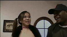 Two kinky Asian girls get together and take turns fucking a black cock