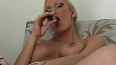 Inviting blonde milf with big tits uses a sex toy to please her snatch