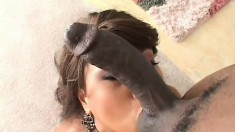 Marvelous Asian babe has a black stud hammering her ass on the couch