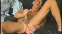 A big rubber dick in Jeff's ass makes his cum from jerking off harder