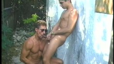 Muscular hunks get down to some hard cocksucking in the outdoors