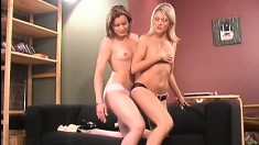 Gorgeous lesbians penetrate each other's slits with a long strap-on