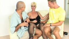 Slutty fishnet MILF pleases two big cocks in a steamy threesome