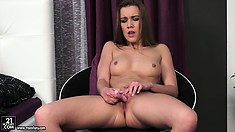 She sits on her chair and sticks her fingers and a dildo in her puss